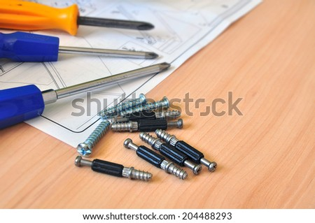 assembly tools on montage instructions - stock photo