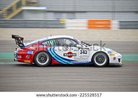 ASSEN, NETHERLANDS - OCTOBER 19, 2014: A porsche 911 at full speed during the supercar challenge and Porsche cup during Acceleration 2014 at the TT Circuit in Assen - stock photo
