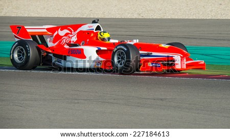 ASSEN, NETHERLANDS - OCTOBER 19, 2014: Nigel Melker, driver of the Dutch Formula A1 team, goes wide over the curbs during the first race. - stock photo