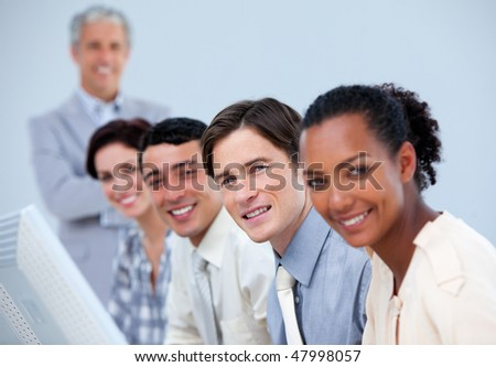 Assertive business partners with their senior manager at work - stock photo