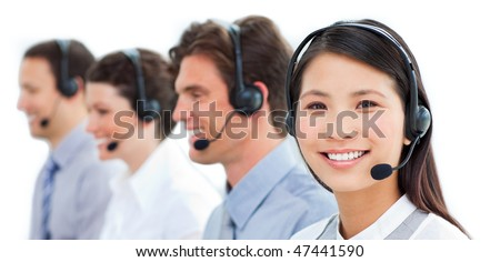 Assertive business people talking on headset in a call center - stock photo