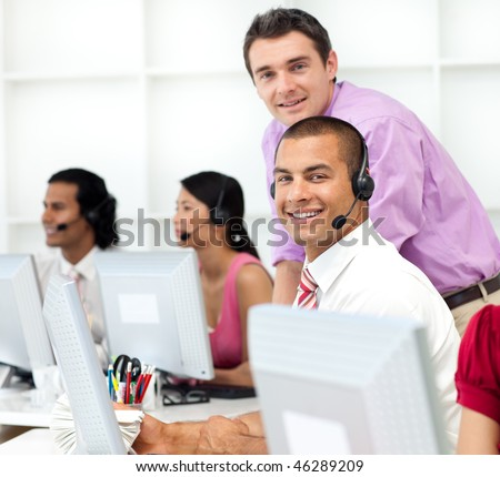 Assertive manager checking his employee's work in the office - stock photo