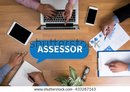 ASSESSOR Business team hands at work with financial reports and a laptop, top view - stock photo
