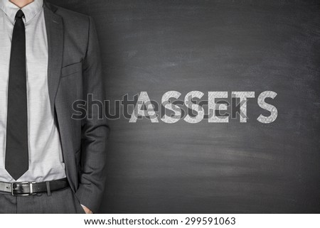 Assets text on black blackboard with businessman - stock photo