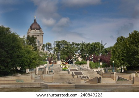 Assiniboine river with Manitoba Legislative Building in the background - stock photo