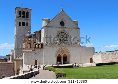ASSISI, ITALY - JUNE 24, 2015: People at Basilica di San Francesco on top of the hill in Assisi, Italy - stock photo