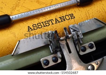 Assistance on typewriter - stock photo