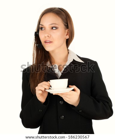 Assistant with headphones and coffee, white background - stock photo
