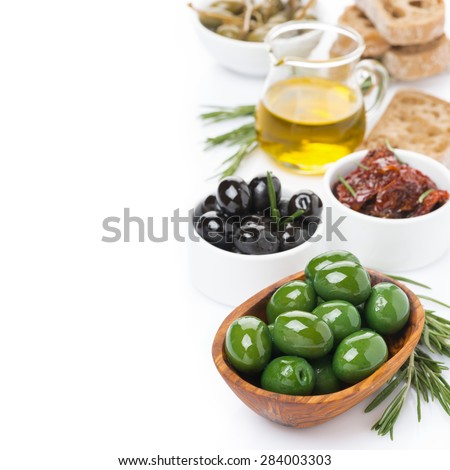 assorted antipasti - olives, pickles, jug of olive oil and ciabatta, top view, isolated on white - stock photo
