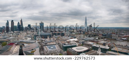 Assorted Architectural London City Buildings in Aerial Panorama View on Gray Sky Above. - stock photo