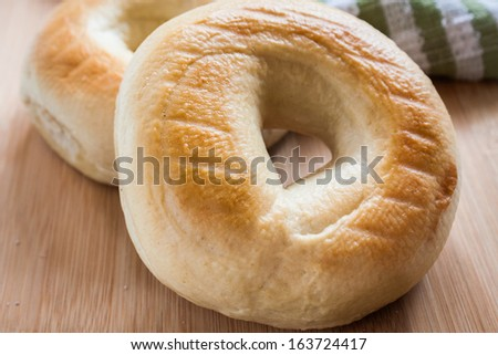 Assorted bagels on a wooden background. - stock photo