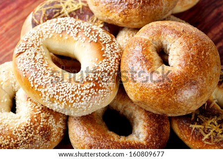 assorted bagels on the wooden surface - stock photo