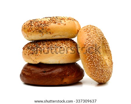 assorted bagels on white background  - stock photo