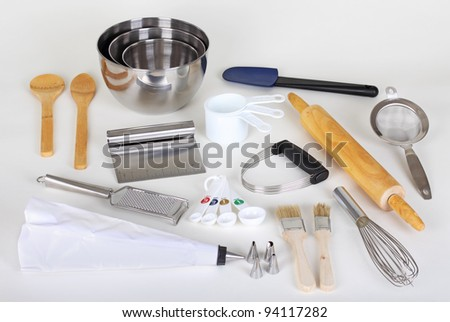 Assorted baking utensils on a white background - stock photo