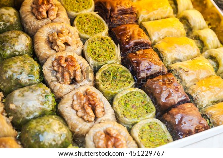 Assorted baklava, it is sweet pastry made of layers of filo with chopped nuts and sweetened and held together with honey. Traditional for former Ottoman Empire and Middle East, selective focus - stock photo