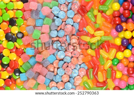 assorted candy in a row - stock photo