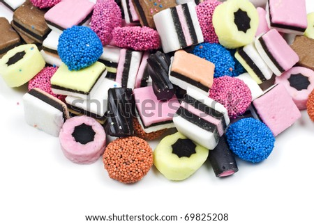Assorted candy sweets and liquorice on white background with space for text - stock photo