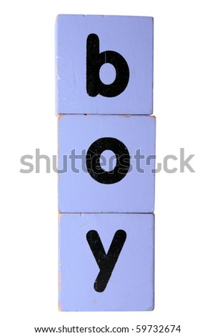 assorted children's toy letter building blocks against a white background that spell boy with clipping path - stock photo