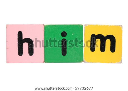 assorted children's toy letter building blocks against a white background that spell him with clipping path - stock photo