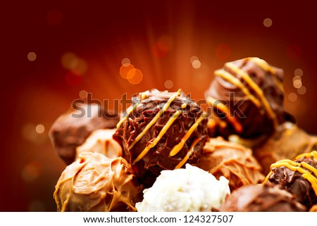 Assorted Chocolate Candies. Chocolate Sweets. Candy Border Design - stock photo