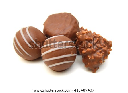 Assorted chocolate candies isolated on white background - stock photo