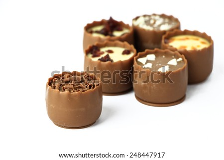 Assorted chocolate confectionery isolated on white - stock photo