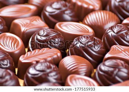 Assorted Chocolate pralines as background - stock photo