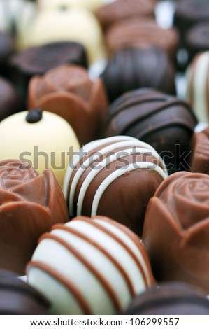 Assorted chocolate pralines. Short depth-of-field - stock photo