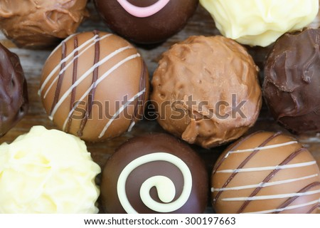 Assorted chocolates and pralines, close up  - stock photo