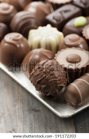 assorted chocolates confectionery on silver tray - stock photo