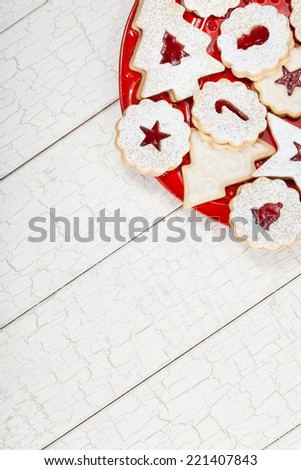 assorted Christmas cookies arranged on a red plate - stock photo