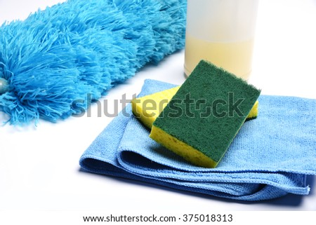 Assorted cleaning items on a white background - stock photo