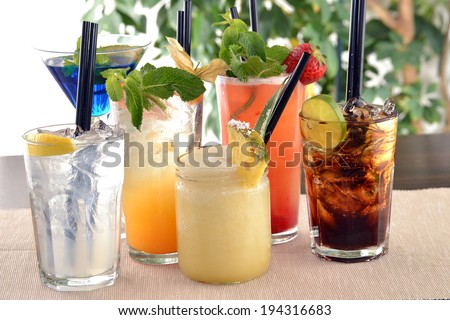 assorted cocktail drinks. - stock photo