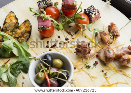 assorted cold appetizers - stock photo