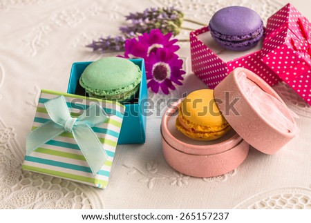 Assorted colorful french macarons food in vintage boxes aerial view Delicious biscuit merinque from France in small gift box with lilac lavender on lace table for bakery business website blog book - stock photo