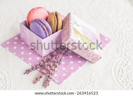 Assorted colorful french macarons in vintage box sweet dessert food  Delicious biscuit merinque from France in small gift box with lilac lavender on polka dot napkin for bakery business website blog - stock photo