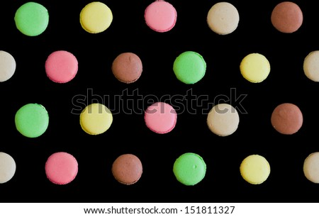 assorted colorful french macarons isolated on black background. seamless pattern - stock photo