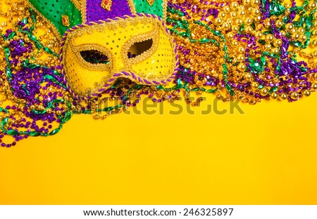 Assorted colorful Mardi Gras mask on yellow background - stock photo