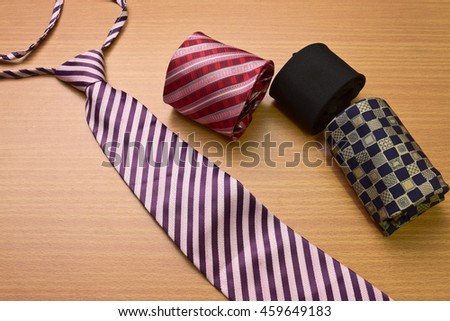 Assorted colorful Necktie on Wood Background - stock photo