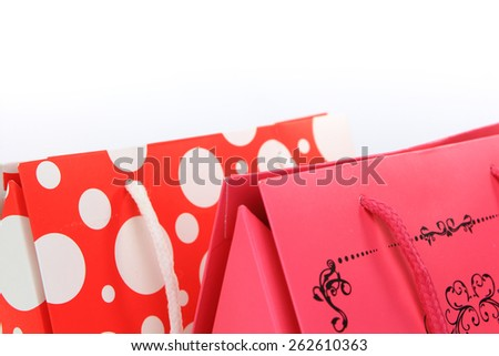 Assorted colorful shopping bags closeup isolated on white - stock photo
