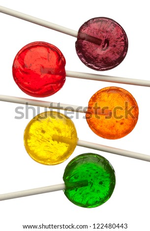Assorted colors lollipops isolated on white background, close-up. This image is isolated with light during the photo shoot process. - stock photo