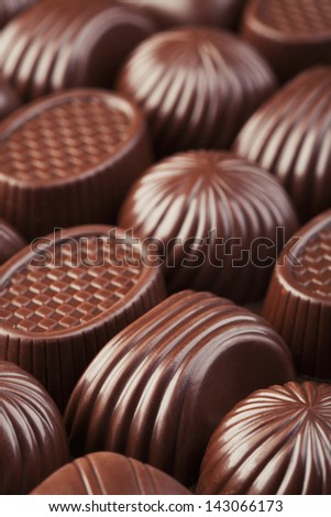 Assorted delicious chocolate candies background - stock photo