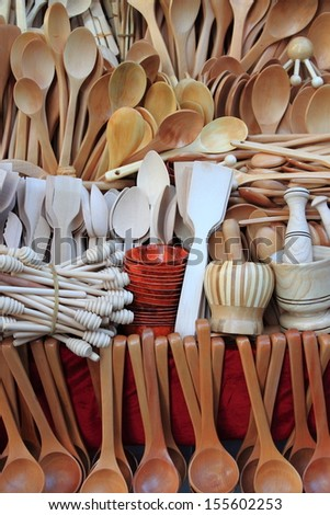 Assorted different kitchen wooden utensils - stock photo