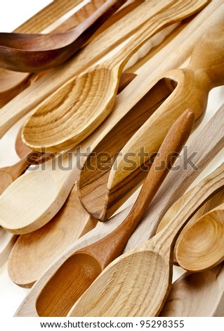 Assorted different kitchen wooden utensils cutlery background - stock photo