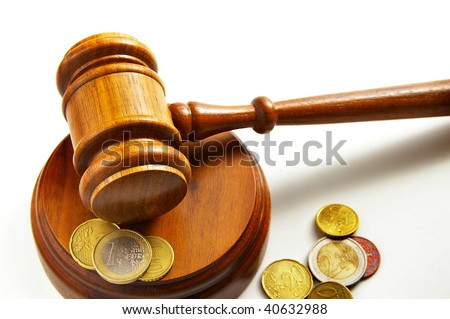 assorted euro coins and a court gavel - stock photo