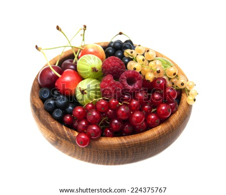 Assorted fresh berries on a white  background - stock photo