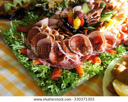 Assorted fresh cold cut platter - sausage, served as a cold buffet - stock photo