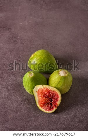 assorted fresh figs on a stone - stock photo