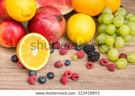 Assorted Fresh Ripe Fruits On Table - stock photo