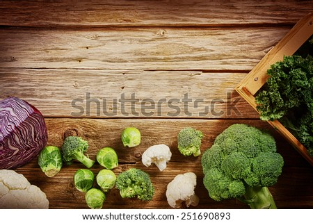 Assorted Fresh Vegetable Ingredients on top of Wooden Table Emphasizing Copy Space for Texts. - stock photo